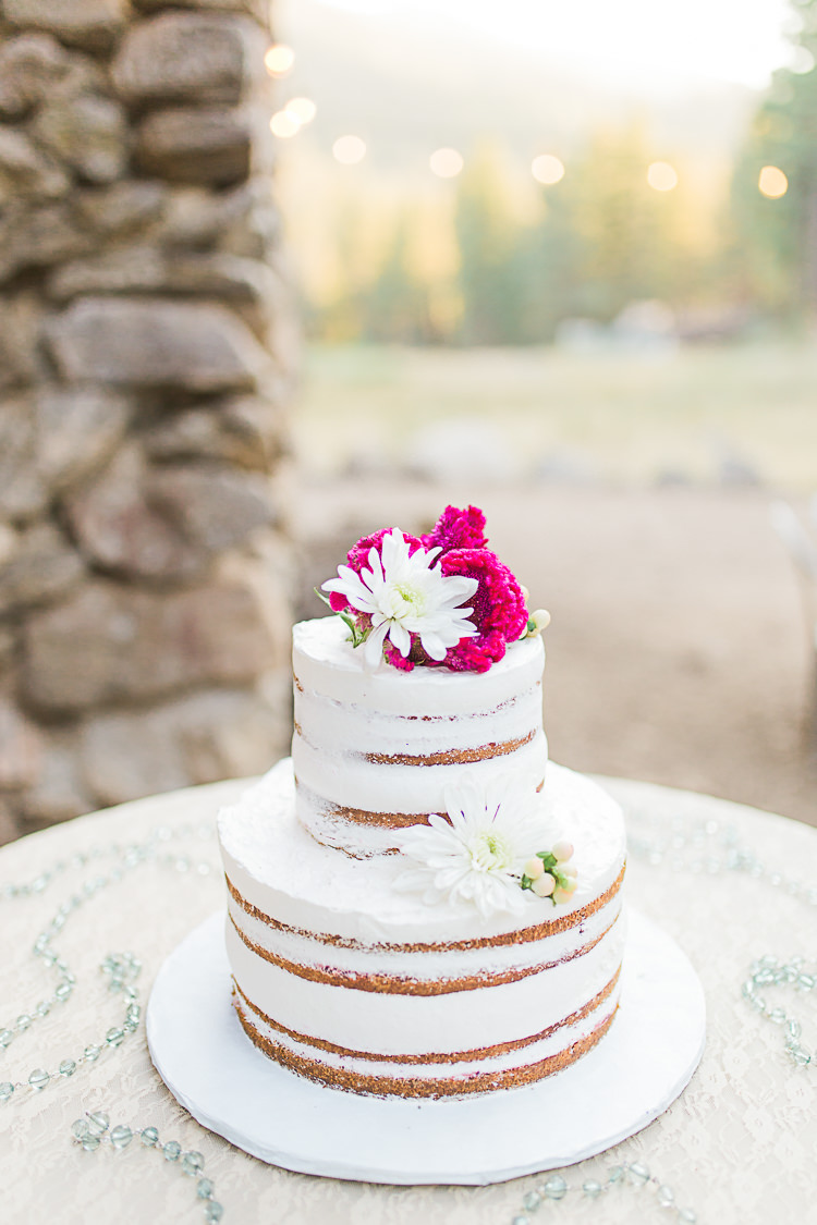 Outdoor Reception Naked Wedding Cake Pink White Fresh Flowers Hanging Fairy Lights DIY Whimsical Camp Wedding California http://www.landbphotography.org/