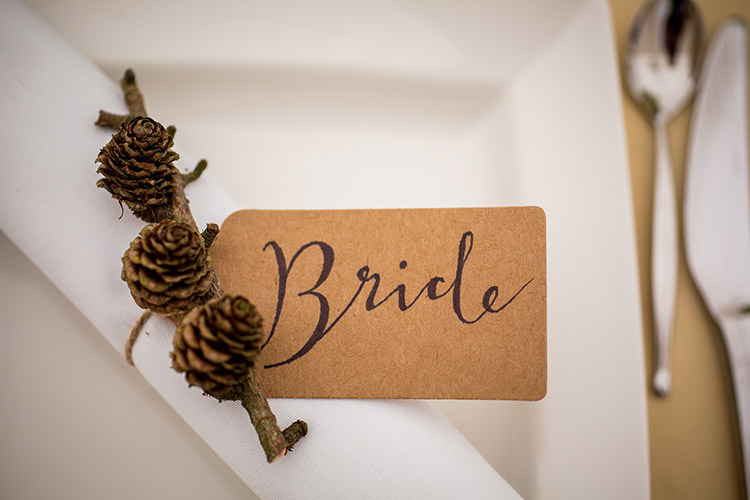 Luggage Tag Calligraphy Pine Cone Twig Place Name Setting Whimsical Greenery Nature Wedding http://lunaweddings.co.uk/