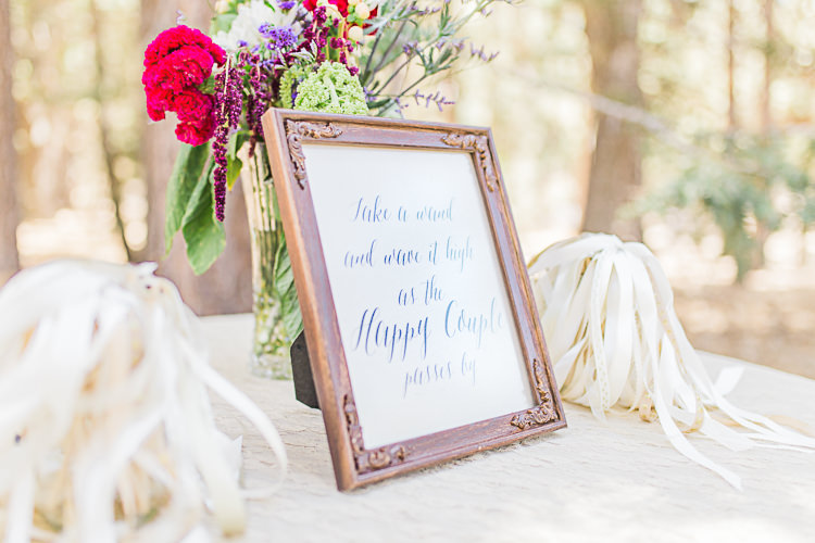 Outdoor Ceremony White Ribbon Wands Framed Calligraphy Sign Multicoloured Flowers Glass Vase DIY Whimsical Camp Wedding California http://www.landbphotography.org/