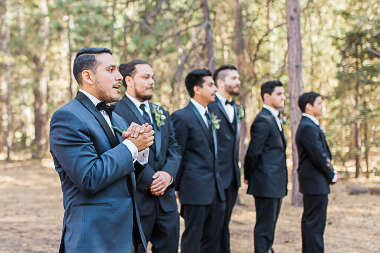 Outdoor Ceremony Groom Dark Blue Jacket Black Satin Lapel Black Bowtie Groomsmen Black Suits Black Bowties Ties DIY Whimsical Camp Wedding California http://www.landbphotography.org/
