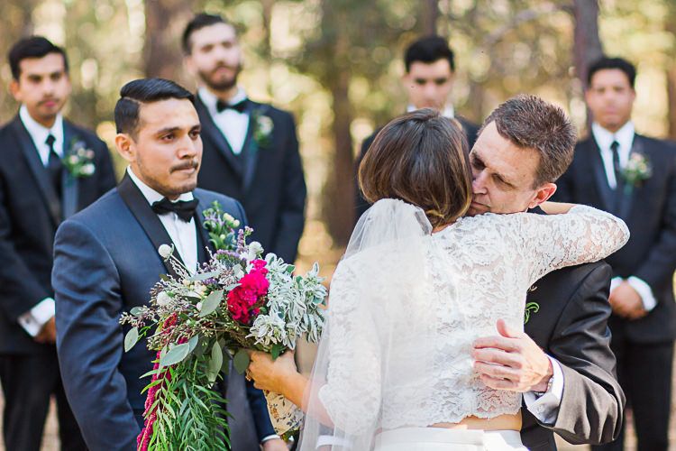 Outdoor Ceremony Bride Watters Separates Lace Top Tulle Skirt Veil Cascading Multicoloured Bouquet Father Groom Dark Blue Jacket Black Satin Lapel Black Bowtie Groomsmen Black Suits Black Bowties Ties DIY Whimsical Camp Wedding California http://www.landbphotography.org/