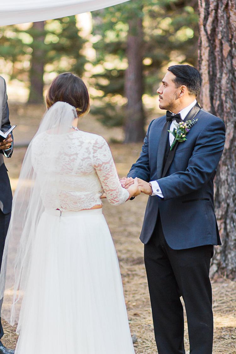 Outdoor Ceremony Bride Watters Separates Lace Top Tulle Skirt Veil Groom Dark Blue Jacket Black Satin Lapel Black Vest Pants Bowtie Floral Buttonhole DIY Whimsical Camp Wedding California http://www.landbphotography.org/