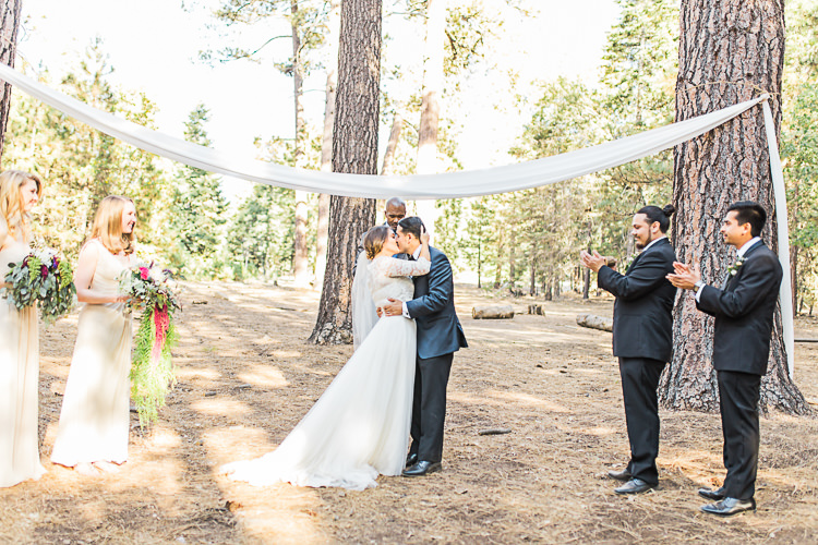 Outdoor Ceremony Bride Watters Separates Lace Top Tulle Skirt Veil Cascading Multicoloured Bouquet Groom Dark Blue Jacket Black Satin Lapel Black Pants Bowtie Groomsmen Black Suits Bridesmaids Ivory Dresses Celebrant DIY Whimsical Camp Wedding California http://www.landbphotography.org/