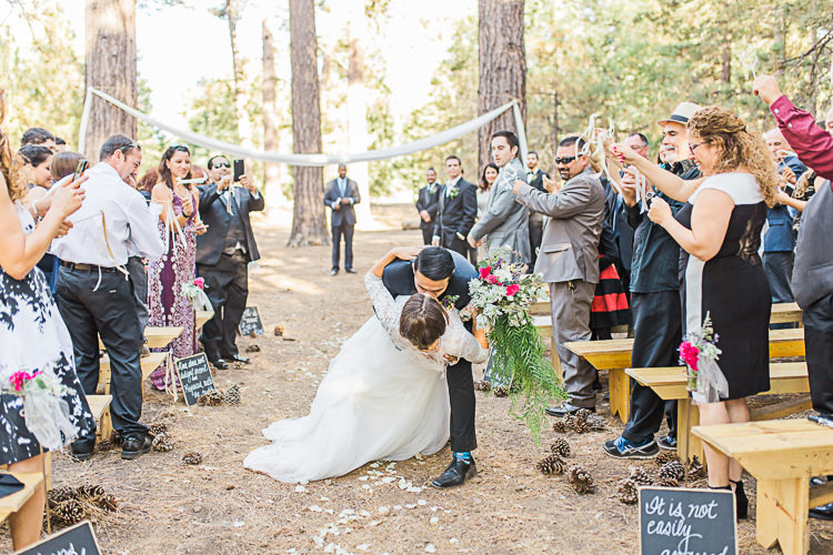 Outdoor Ceremony Bride Watters Separates Lace Top Tulle Skirt Cascading Multicoloured Bouquet Groom Dark Blue Jacket Black Pants Kiss Guests DIY Whimsical Camp Wedding California http://www.landbphotography.org/