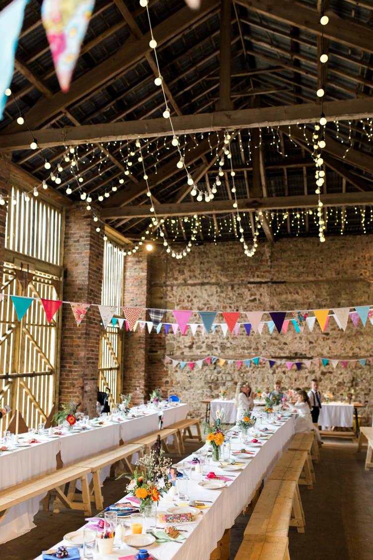 Barn Bunting Festoon Lights Long Tables Colourful Decor Beautiful Woodland Glade Wedding https://emilyhannah.com/