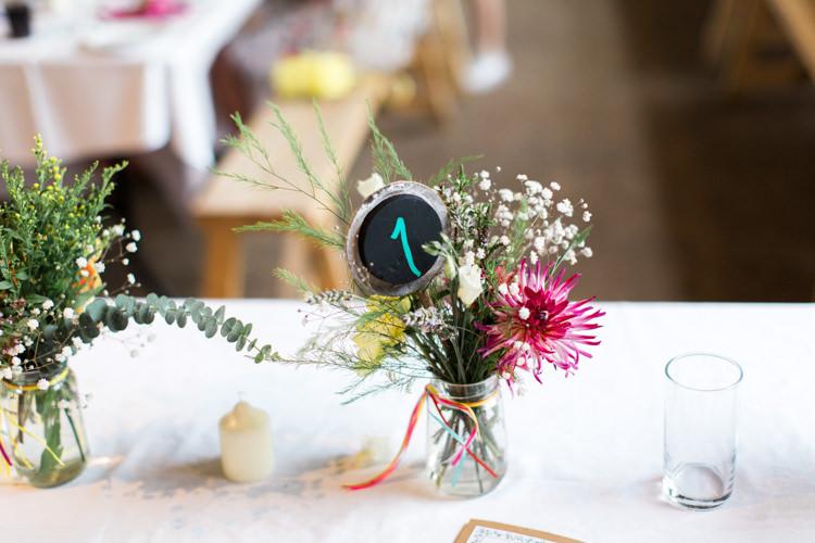 Jar Flowers Chalk Board Table Numbers Beautiful Woodland Glade Wedding https://emilyhannah.com/