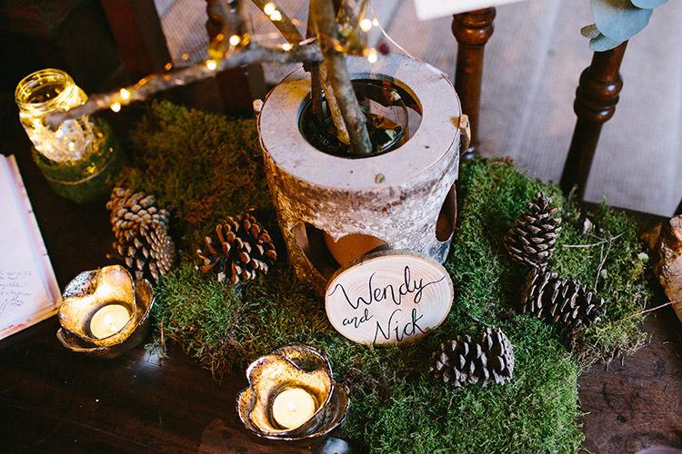 Moss Candles Pine Cones Decor Wooden Sign Enchanted Fairy Garden Wedding http://lunaweddings.co.uk/