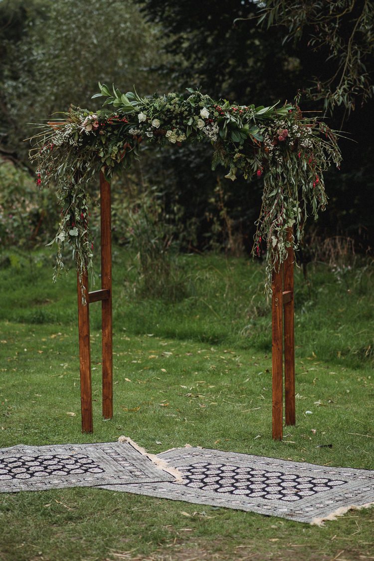 Wooden Arch Arbour Flowers Greenery Foliage Ceremony Backdrop Bohemian Festival Tipi Wedding http://esmemai.com/