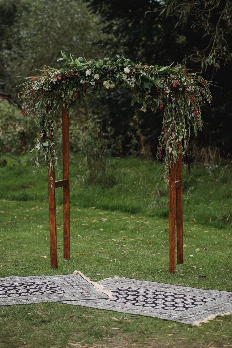 Wooden Arch Arbour Flowers Greenery Foliage Ceremony Backdrop Bohemian Festival Tipi Wedding http://esmemai.com/