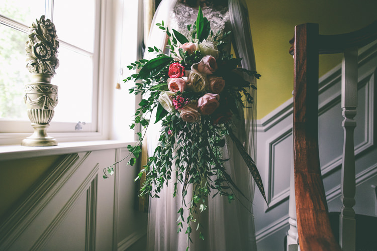 Pink Red Rose Bouquet Greenery Foliage Large Feathers Cascading Rustic Woodland Birds Outdoorsy Wedding http://www.emmaboileau.co.uk/