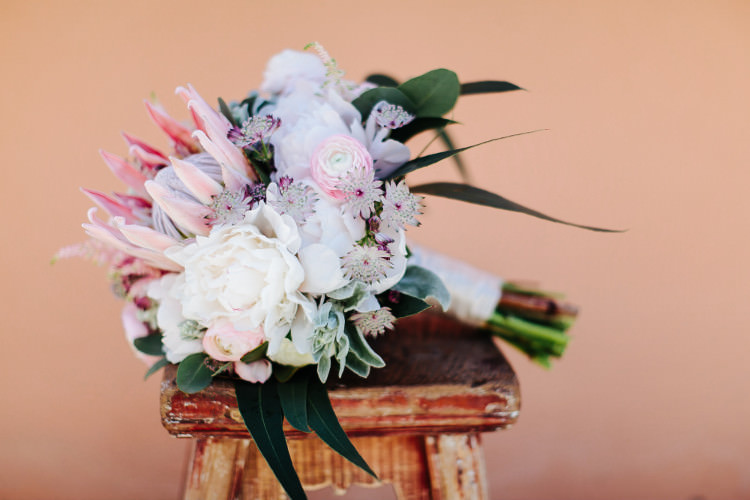 Bride Bouquet White Pink Peonies Protea Eucalyptus Cream Ribbon Beautiful Pink Blue Tuscany Villa Wedding http://www.chloemurdochphotography.com/