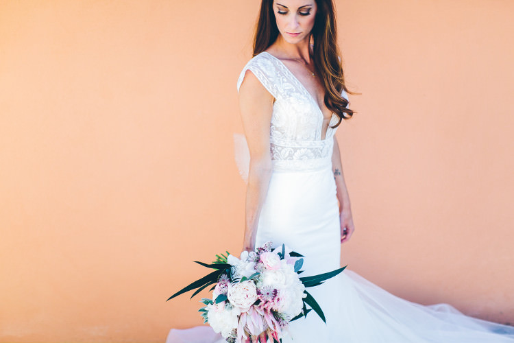 Bride Lace Mermaid Two Piece Bridal Gown Bouquet Pink White Peonies Protea Eucalyptus Beautiful Pink Blue Tuscany Villa Wedding http://www.chloemurdochphotography.com/