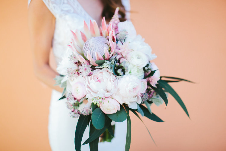 Bride Lace Two Piece Bridal Gown Bouquet Pink White Peonies Protea Eucalyptus Florals Beautiful Pink Blue Tuscany Villa Wedding http://www.chloemurdochphotography.com/