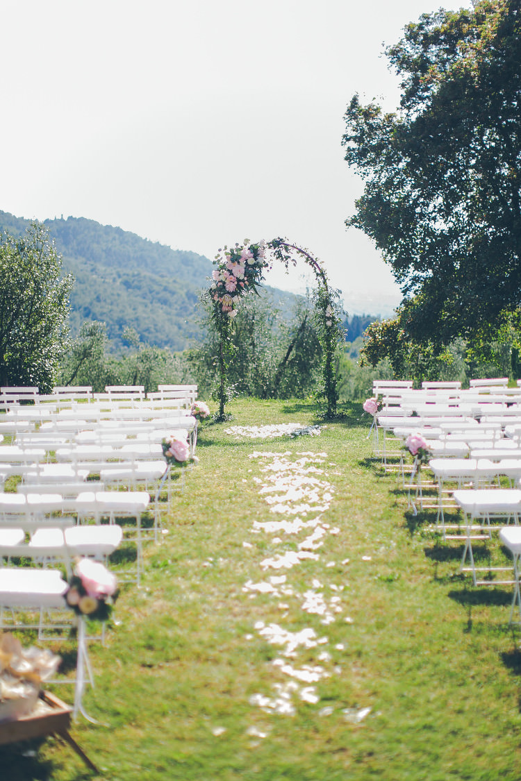 Outdoor Ceremony Floral Arch White Chairs Pink Flowers White Petals Beautiful Pink Blue Tuscany Villa Wedding http://www.chloemurdochphotography.com/
