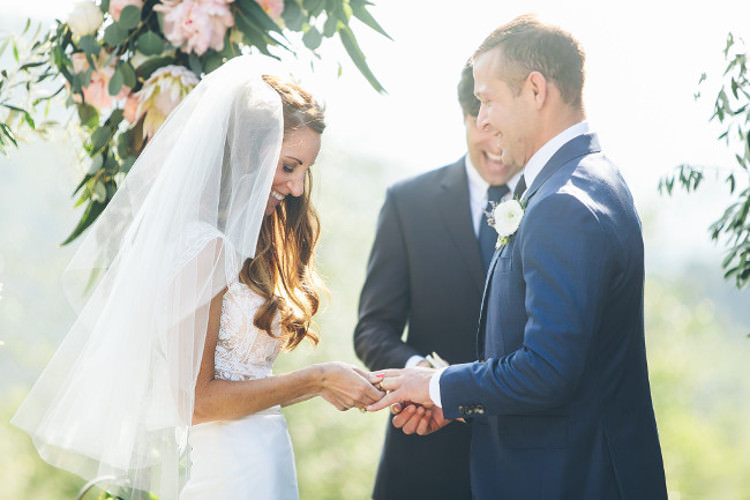 Outdoor Ceremony Bride Lace Mermaid Two Piece Bridal Gown Veil Groom Royal Blue Suit Celebrant Floral Arch Beautiful Pink Blue Tuscany Villa Wedding http://www.chloemurdochphotography.com/
