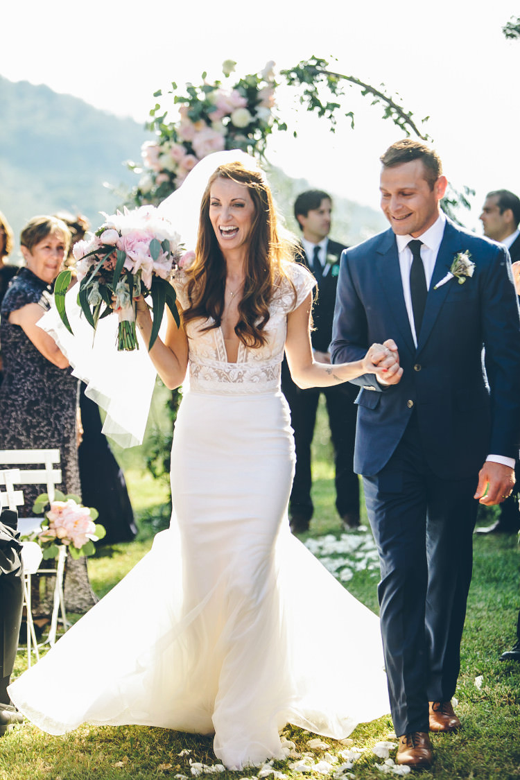 Outdoor Ceremony Bride Two Piece Mermaid Bridal Gown Veil Bouquet Groom Royal Blue Suit White Shirt Dark Blue Tie Floral Arch Guests Beautiful Pink Blue Tuscany Villa Wedding http://www.chloemurdochphotography.com/