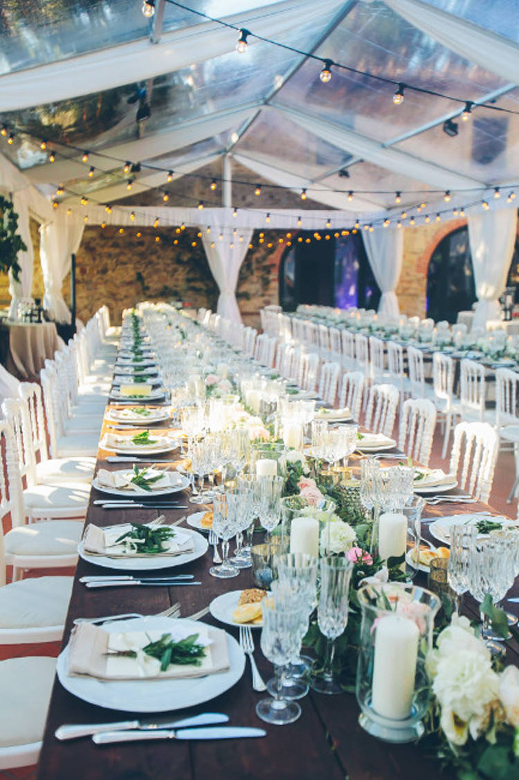 Reception Marquee Hanging Fairy Lights Wooden Table White Chairs Florals Greenery Crystal Candleholders Beautiful Pink Blue Tuscany Villa Wedding http://www.chloemurdochphotography.com/
