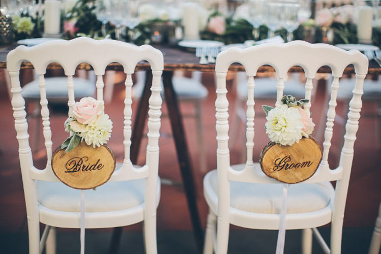 Reception Bridal Party Table White Chairs Wooden Bride Groom Signs White Pink Florals Beautiful Pink Blue Tuscany Villa Wedding http://www.chloemurdochphotography.com/
