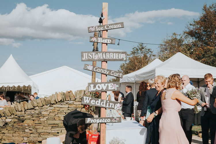 Rustic Wooden Sign Post Beautiful Flowery Country Marquee Wedding http://www.maddiefarrisphotography.co.uk/