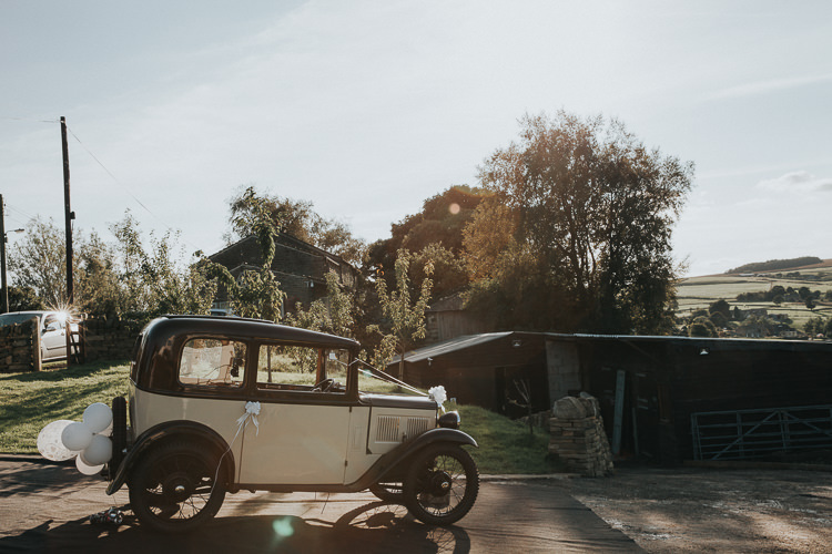 Classic Vintage Car Transport Beautiful Flowery Country Marquee Wedding http://www.maddiefarrisphotography.co.uk/