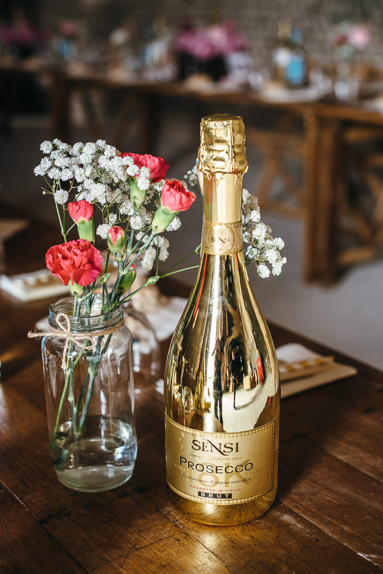 Prosecco Drink Bottle Jar Flowers Decor Gorgeous Home Made Pink Gold Barn Wedding http://www.bethmoseleyphotography.co.uk/