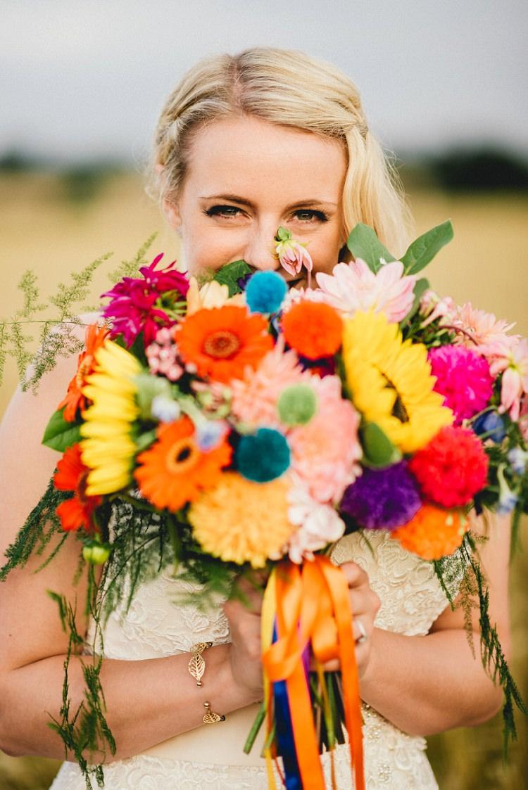 Bouquet Flowers Rainbow Pom Poms Ribbons Bride Bridal Sunflowers Gerbera Dahlia All Things Big Bright Beautiful Multicolour Wedding http://benjaminmathers.co.uk/