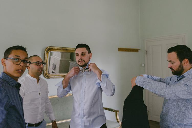 Groom Light Blue Shirt Patterned Bowtie Ceremony Preparations Natural Greenery Stylish Wedding Transylvania https://raresion.com/