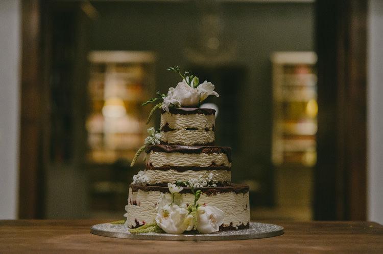 Layered Naked Wedding Cake Chocolate Sponge Mousse White Florals Natural Greenery Stylish Wedding Transylvania https://raresion.com/