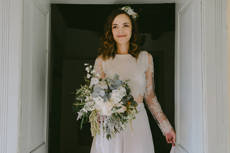 Bride Two Piece Lace Bridal Gown Floral Headpiece Bouquet White Florals Roses Greenery White Ribbon Loose Curls Hairstyle Natural Greenery Stylish Wedding Transylvania https://raresion.com/