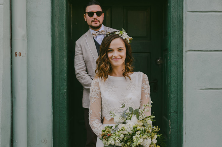 Bride Two Piece Lace Bridal Gown Floral Hairpiece Groom Light Blue Shirt Sand Jacket Dark Grey Vest Brown Pants Patterned Bowtie Sunglasses Natural Greenery Stylish Wedding Transylvania https://raresion.com/