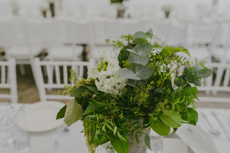 Reception Centrepiece White Floral Greenery Fruit Arrangement Silver Vase White Chairs Natural Greenery Stylish Wedding Transylvania https://raresion.com/