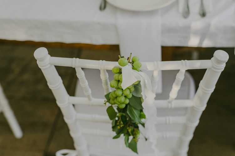 Reception White Chairs Grapes Greenery White Ribbon Natural Greenery Stylish Wedding Transylvania https://raresion.com/