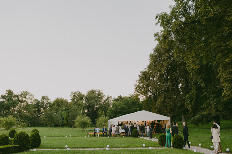 Reception White Marquee Guests Trees Natural Greenery Stylish Wedding Transylvania https://raresion.com/