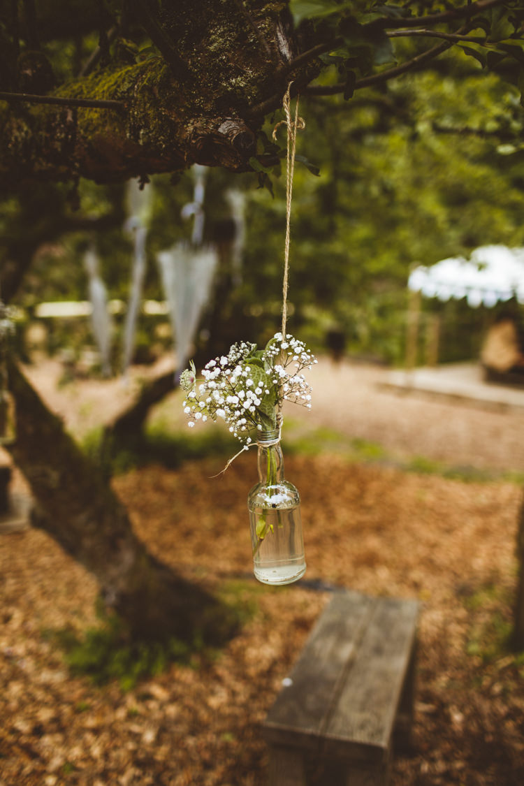 Hanging Bottle Flowers Trees Pretty DIY Outdoor Village Hall Wedding https://photography34.co.uk/