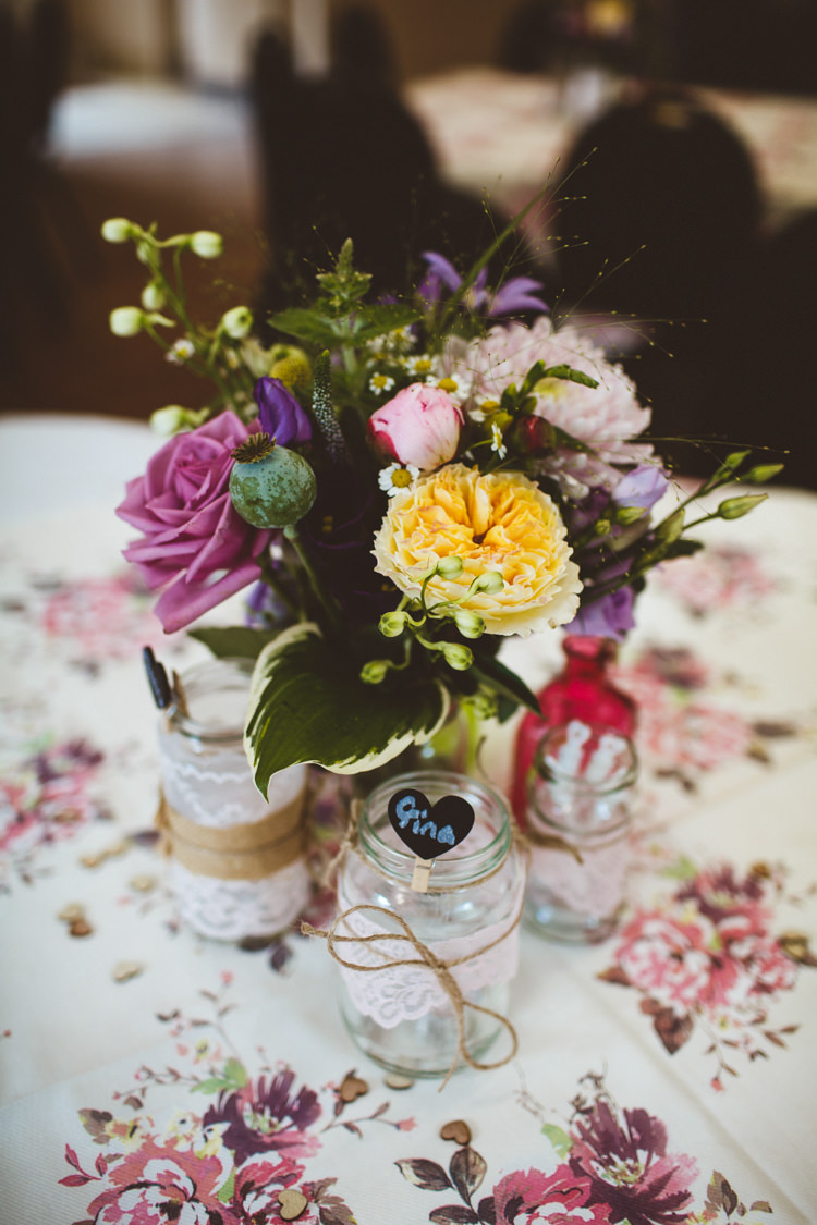 Table Flowers Centrepiece Decor Pink Yellow Lace Twine Jars Floral Table Cloth Runner Pretty DIY Outdoor Village Hall Wedding https://photography34.co.uk/