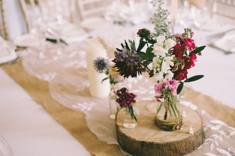 Log Slice Flowers Jars Pretty Light Pink Country House Wedding http://jonathanryderphotography.com/