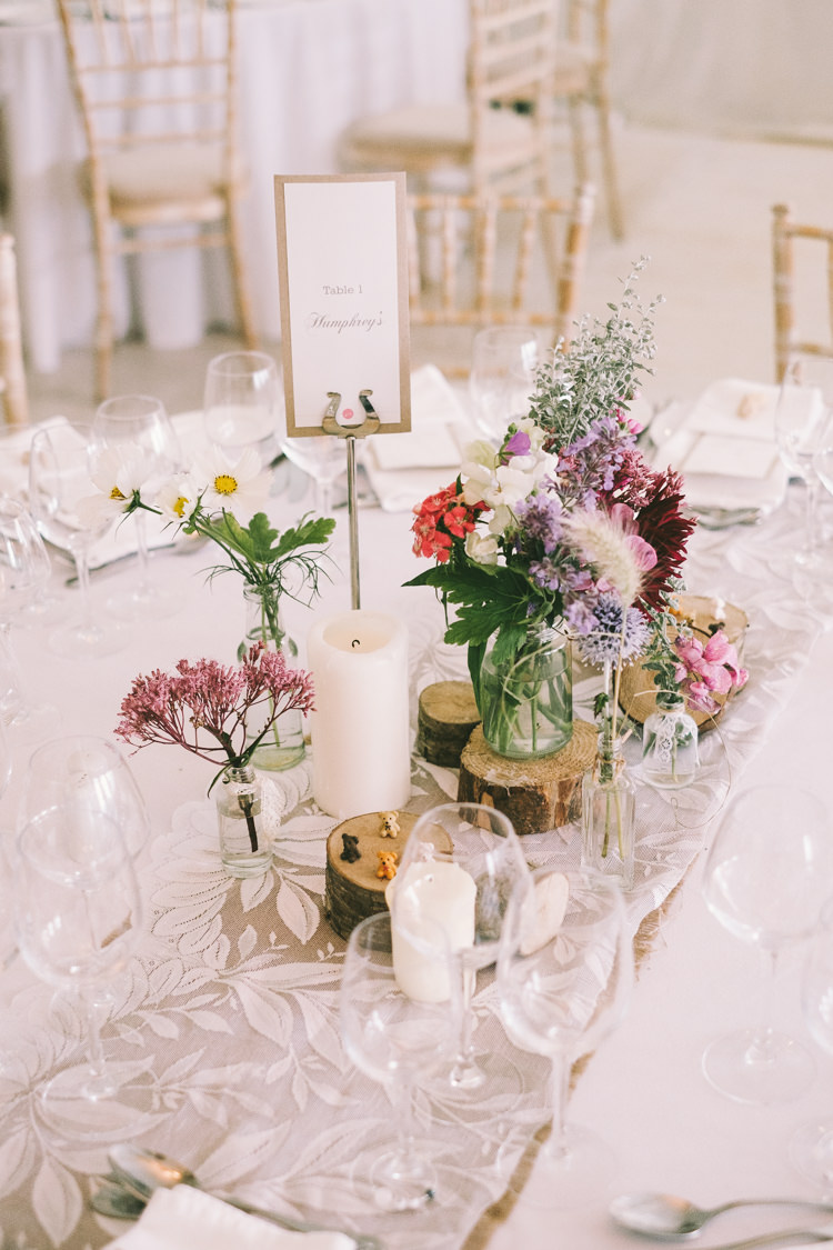 Table Centrepiece Flowers Jars Log Slices Lace Candles Pretty Light Pink Country House Wedding http://jonathanryderphotography.com/
