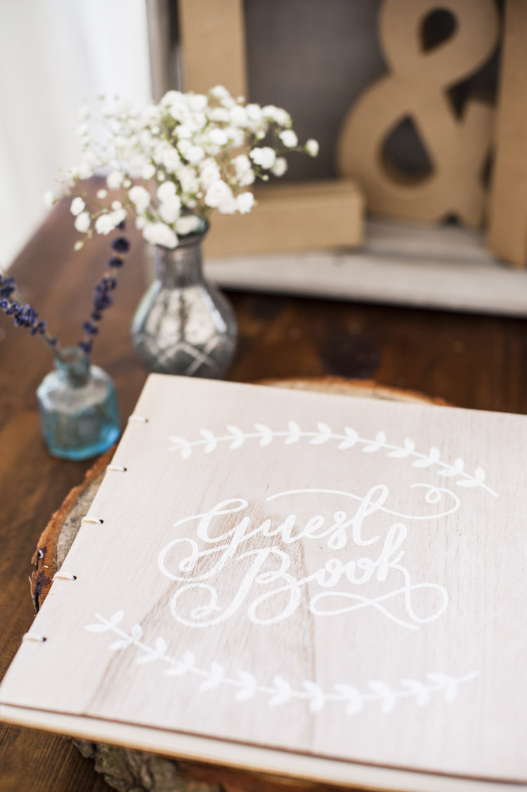 Wooden Guest Book Whimsical Summery Lilac Wedding http://eleanorjaneweddings.co.uk/