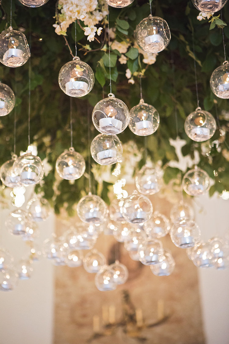 Hanging Tealights Floral Installation Elegant Luxe Red Blue Winter Wedding http://www.bennicarolweddingphotography.com/