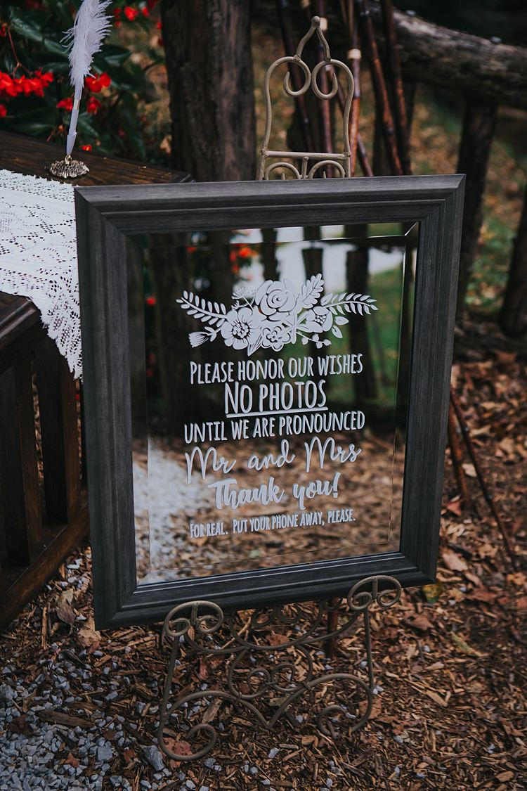 Outdoor Ceremony No Phones Please Mirror Framed Sign White Calligraphy Guestbook Table Bohemian & Whimsical Garden Wedding in North Carolina http://www.taylorparkerphotography.com/