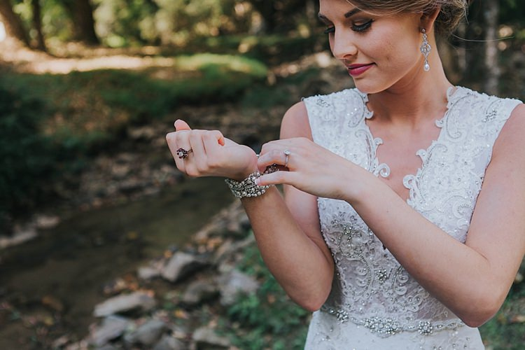 Bride V Neck Lace Embellished Bridal Gown Drop Crystal Pearl Earrings Pearl Bracelet Bohemian & Whimsical Garden Wedding in North Carolina http://www.taylorparkerphotography.com/