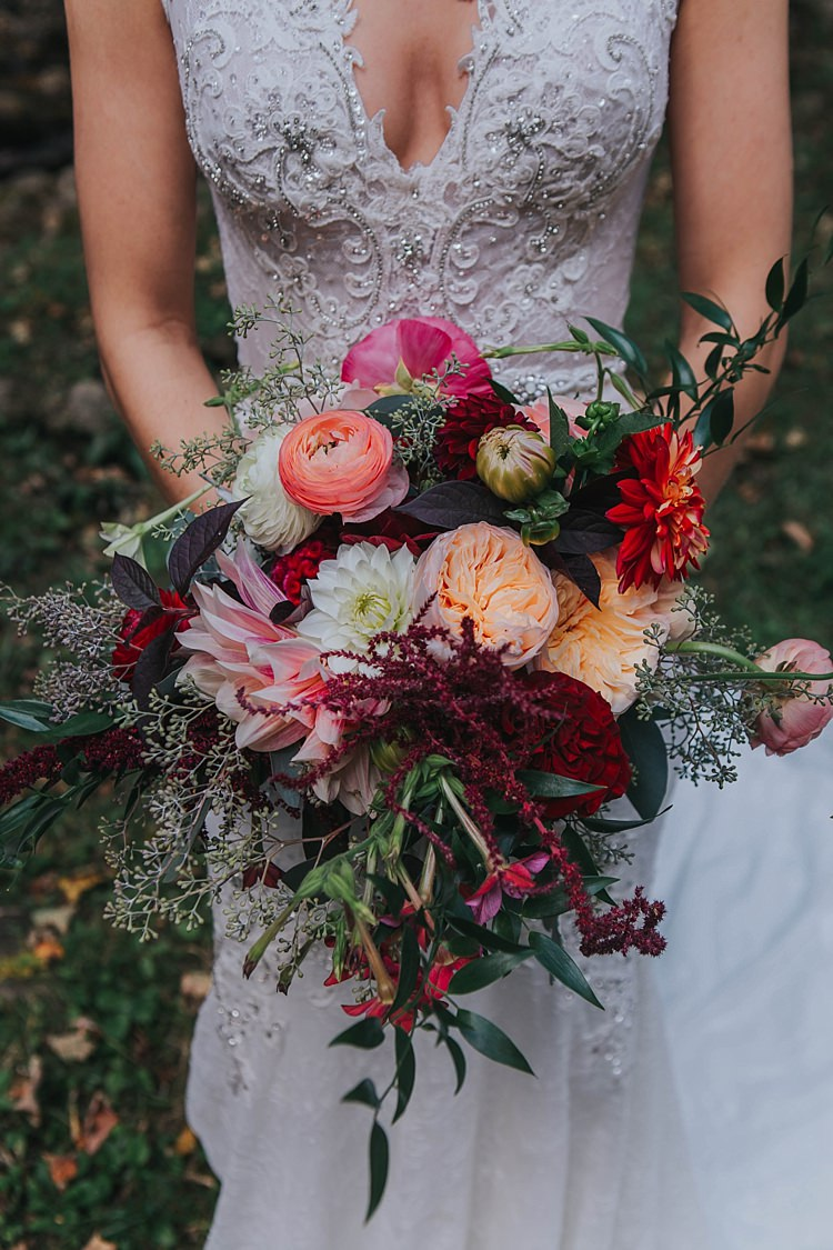 Bride Lace V Neck Embellished Bridal Gown Multicoloured Bouquet Dahlia Tea Rose Florals Greenery Bohemian & Whimsical Garden Wedding in North Carolina http://www.taylorparkerphotography.com/