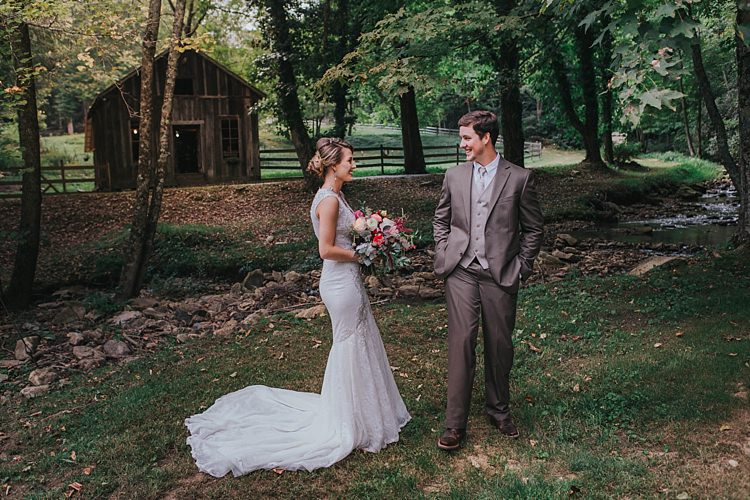 Outdoor First Look Bride V Neck Lace Embellished Bridal Gown Multicoloured Bouquet Groom Grey Suit White Shirt Light Grey Tie Vest Bohemian & Whimsical Garden Wedding in North Carolina http://www.taylorparkerphotography.com/