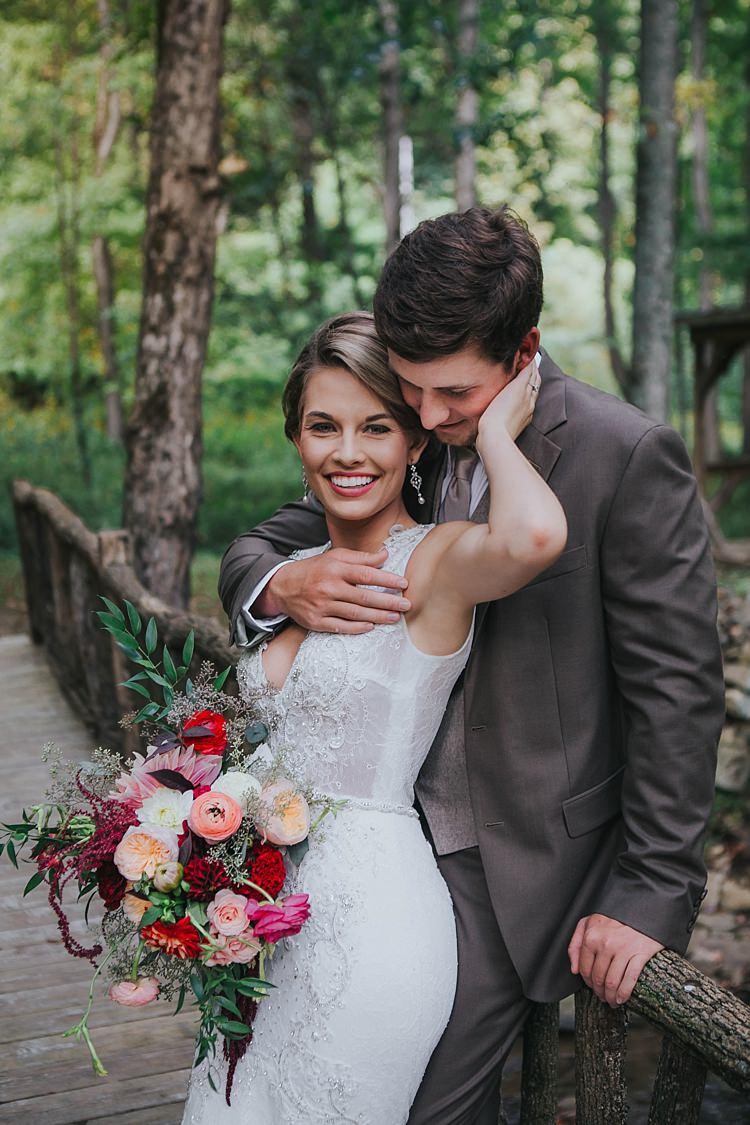 Outdoor First Look Bride V Neck Lace Embellished Bridal Gown Multicoloured Bouquet Groom Grey Suit White Shirt Light Grey Tie Bohemian & Whimsical Garden Wedding in North Carolina http://www.taylorparkerphotography.com/