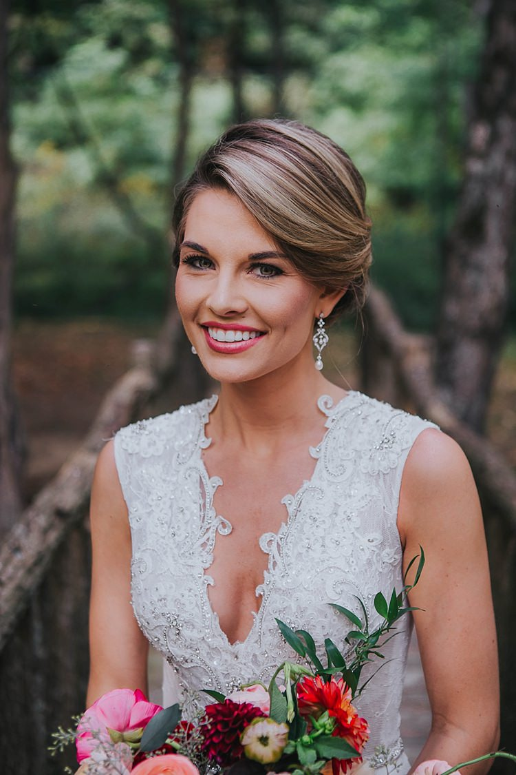 Bride V Neck Lace Embellished Bridal Gown Drop Crystal Pearl Earrings Multicoloured Bouquet Bohemian & Whimsical Garden Wedding in North Carolina http://www.taylorparkerphotography.com/