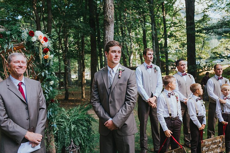 Outdoor Ceremony Groom Grey Suit White Shirt Light Grey Tie Vest Celebrant Groomsmen White Shirt Light Grey Vest Maroon Bowties Floral Arch Bohemian & Whimsical Garden Wedding in North Carolina http://www.taylorparkerphotography.com/