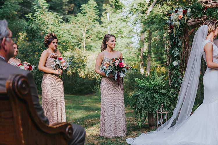 Outdoor Ceremony Bride Lace Embellished Gown Long Veil Bridesmaids Champagne Sequin Dresses Multicoloured Bouquets Floral Arch Bohemian & Whimsical Garden Wedding in North Carolina http://www.taylorparkerphotography.com/