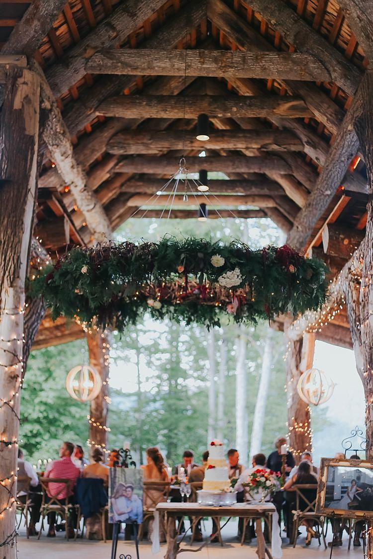 Reception Fairy Lights Large Hanging Décor Greenery Florals Lanterns Wedding Cake Guests Bohemian & Whimsical Garden Wedding in North Carolina http://www.taylorparkerphotography.com/