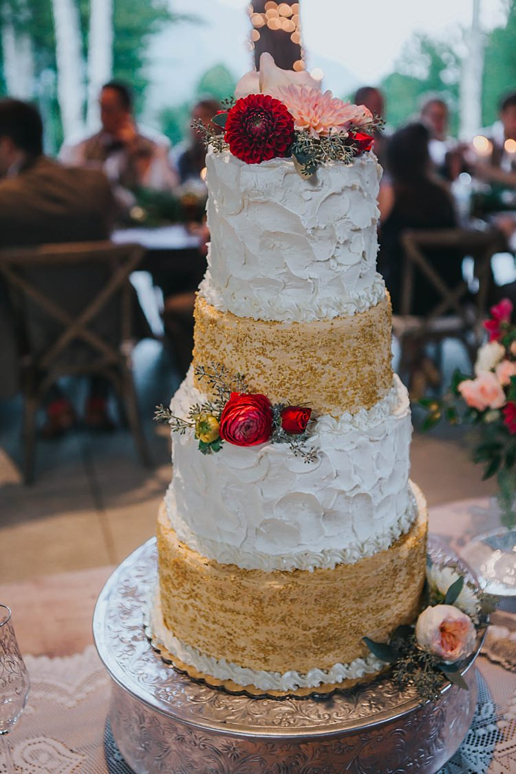 Reception Wedding Cake Four Tiers Textured Buttercream Gold Sequin Icing Multicoloured Florals Metallic Cake Stand Bohemian & Whimsical Garden Wedding in North Carolina http://www.taylorparkerphotography.com/
