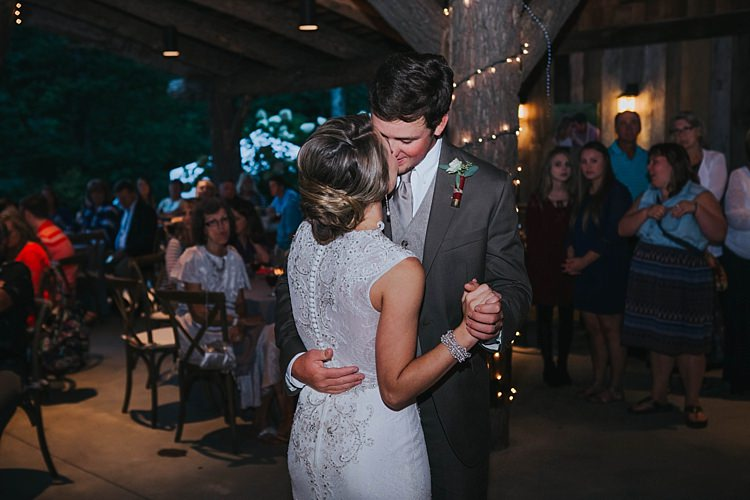 Reception First Dance Bride V Neck Lace Embellished Gown Groom Grey Suit White Shirt Light Grey Tie Vest Shotgun Shell Floral Buttonhole Guests Bohemian & Whimsical Garden Wedding in North Carolina http://www.taylorparkerphotography.com/